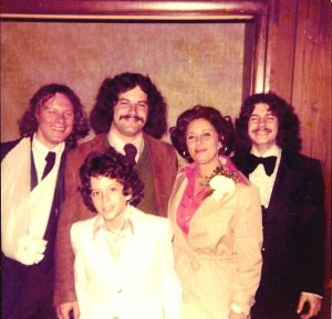 Surrounded by her best audience and her most willing court jesters, 1976