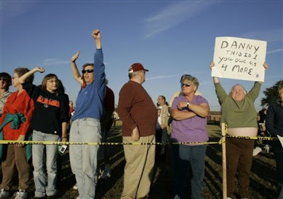 Death penalty supporters cheer outside the Florida State Prison moments after the execution of Danny Rolling in Starke, Fla., in this Oct. 25, 2006 file photo.